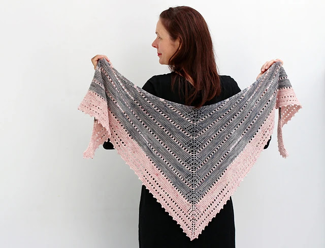 Two color garter and lace knit shawl inspired by ancient runes.