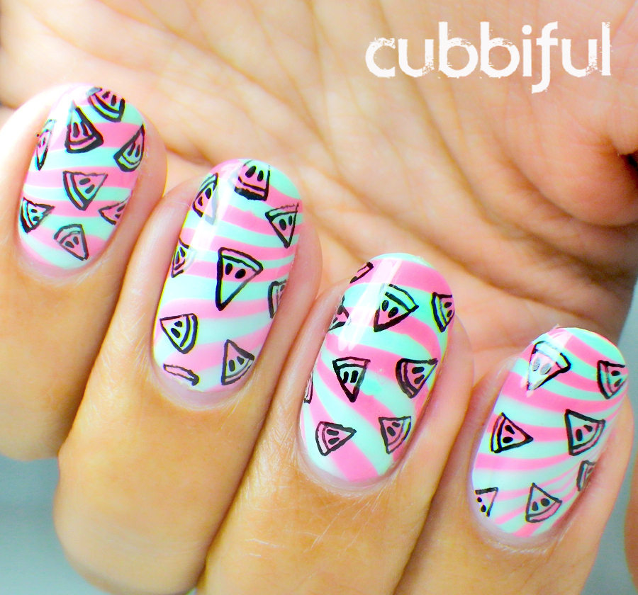 cute watermelon nails with a watermarble background
