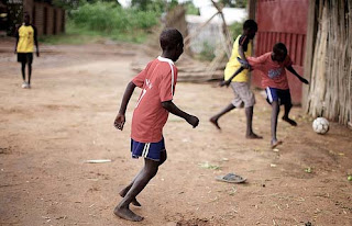 Playing soccer in Ghana.