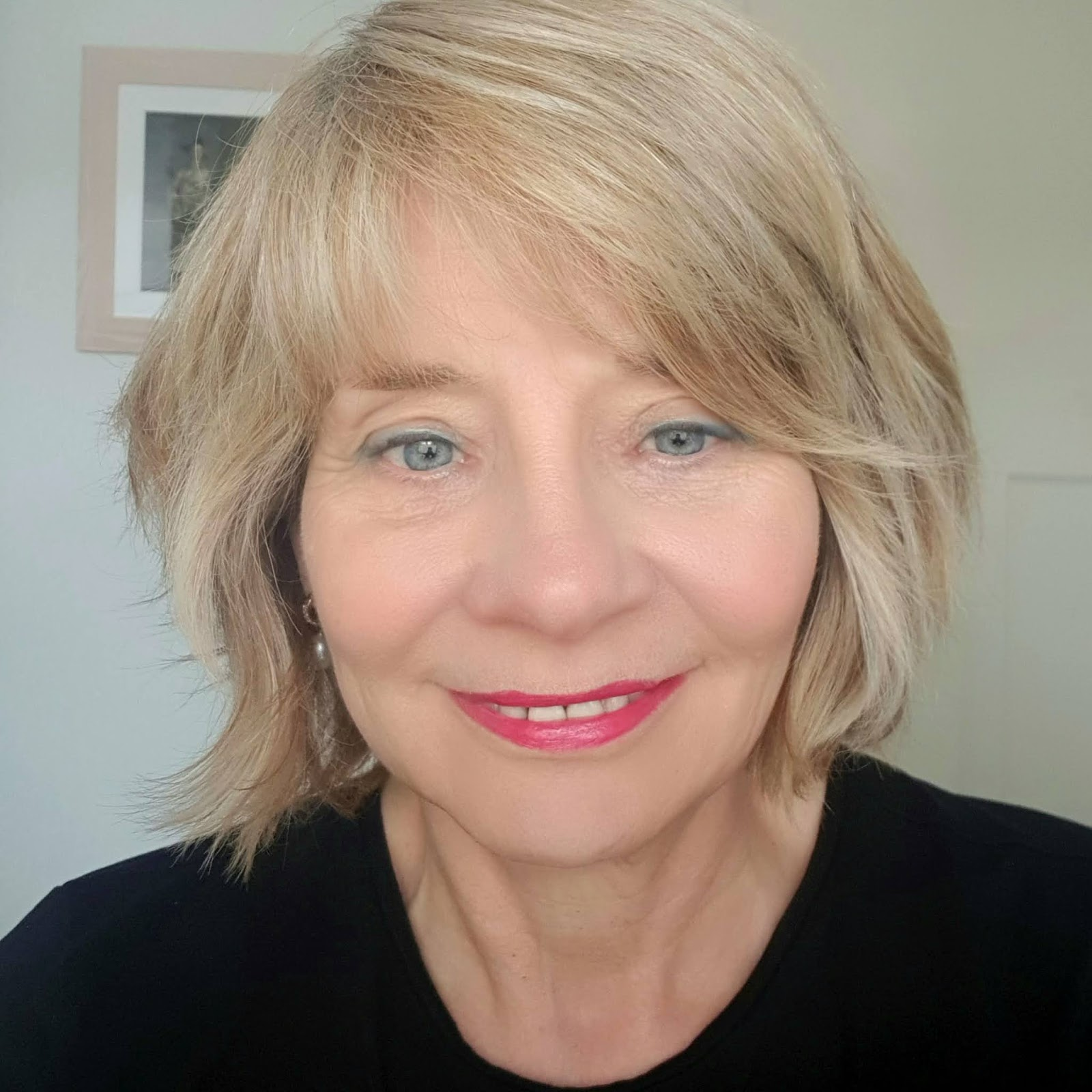 Over 50s woman breaks a makeup rule by wearing a blue eyeshadow as eyeliner. Shock!