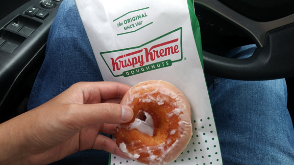 About to enjoy this Original Glazed Doughnut that I got for free from Krispy Kreme...courtesy of my COVID-19 vaccination record card on April 21, 2021.