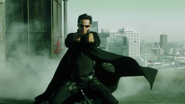 Keanu Reeves firing two pistols in The Matrix