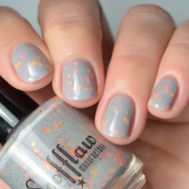 grey crelly nail polish with glitter