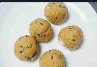 Making round shaped dough balls for Methi paratha recipe