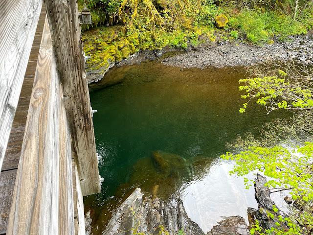 Tropical blue creek water seen from a wooden bridge