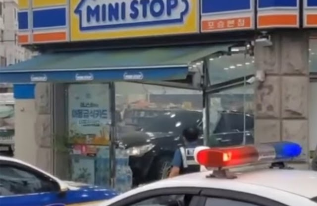 Angry woman drives her car into a convenience store