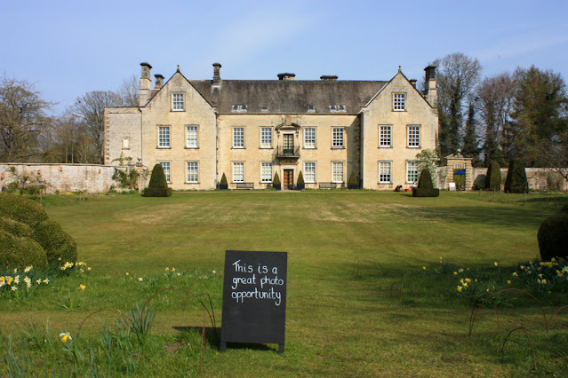 Photo of Nunnington Hall with the blackboard sign in the foreground.