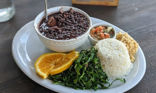 Feijoada plate with all the accoutrement