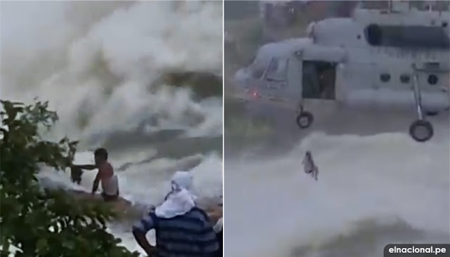 Rescatan desde un helicóptero a un hombre atrapado por las inundaciones en La India