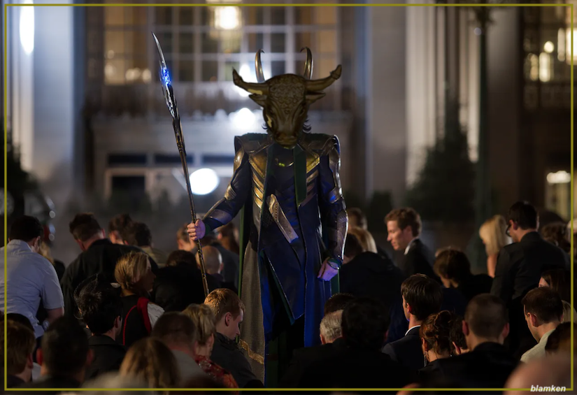 photo-illustration of Tom Hiddleston as Loki standing amidst kneeling crowd with Golden Calf's head