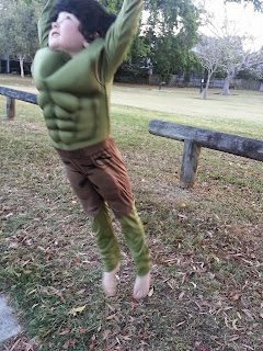 Photo of boy in hulk costume, jumping.