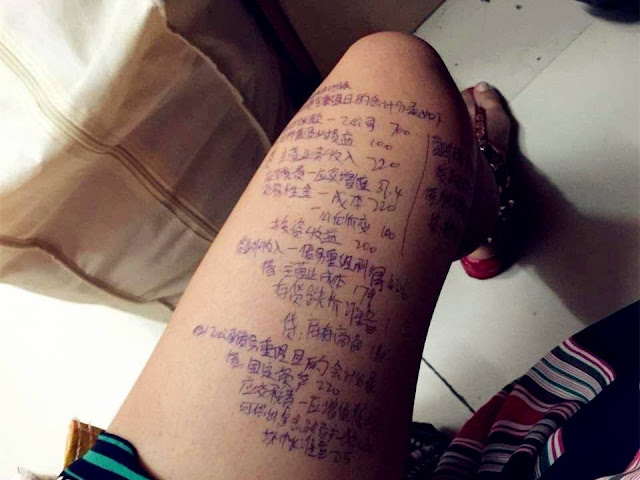 Student uses her leg as exam cheat sheet