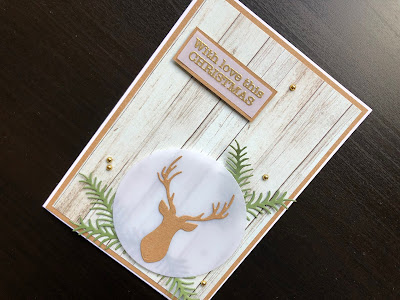 Hand made Christmas card with die cut stags head on vellum with woodgrain background