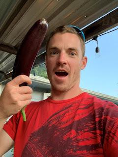 Farmer Man Holding Eggplant