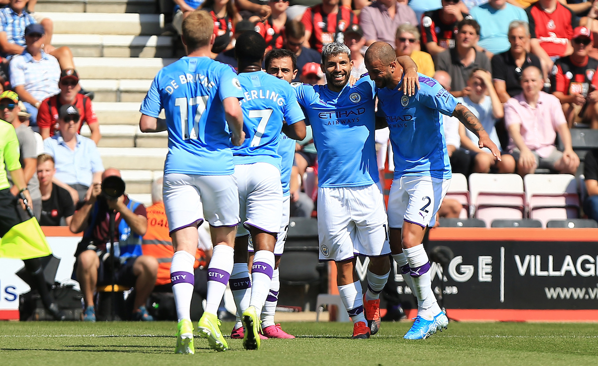 Manchester City players celebrating a goal