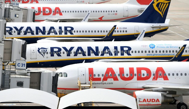 Ryanair and Lauda aircraft on the tarmac at the airport