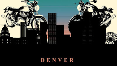 Denver skyline with Royal Enfield 650 twins behind it.