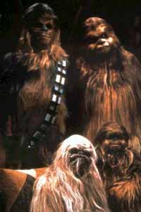 "Chewbacca goes home for the holidays  in the virtually forgotten ""Star Wars Holiday Special."" His family was designed by special effects wizard Stan Winston, who would go on to better things."