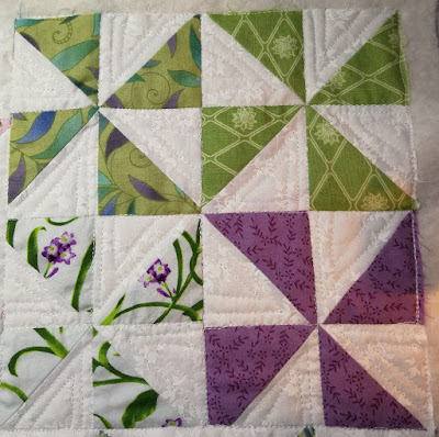 pinwheel blocks quilted with triangles