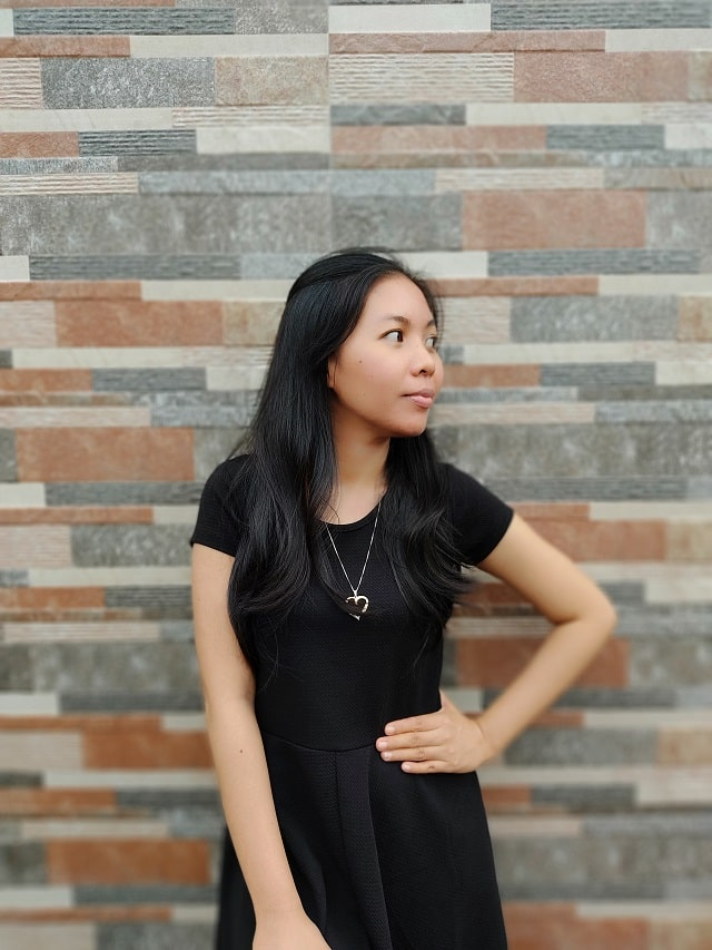 Lux wearing black dress_oNecklace jewelry