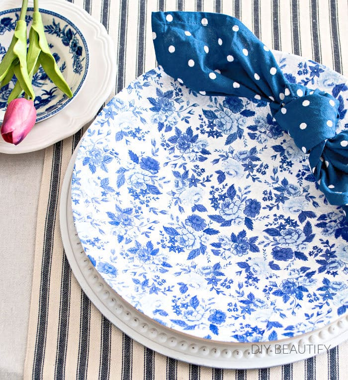 decoupage chargers with blue and white napkins