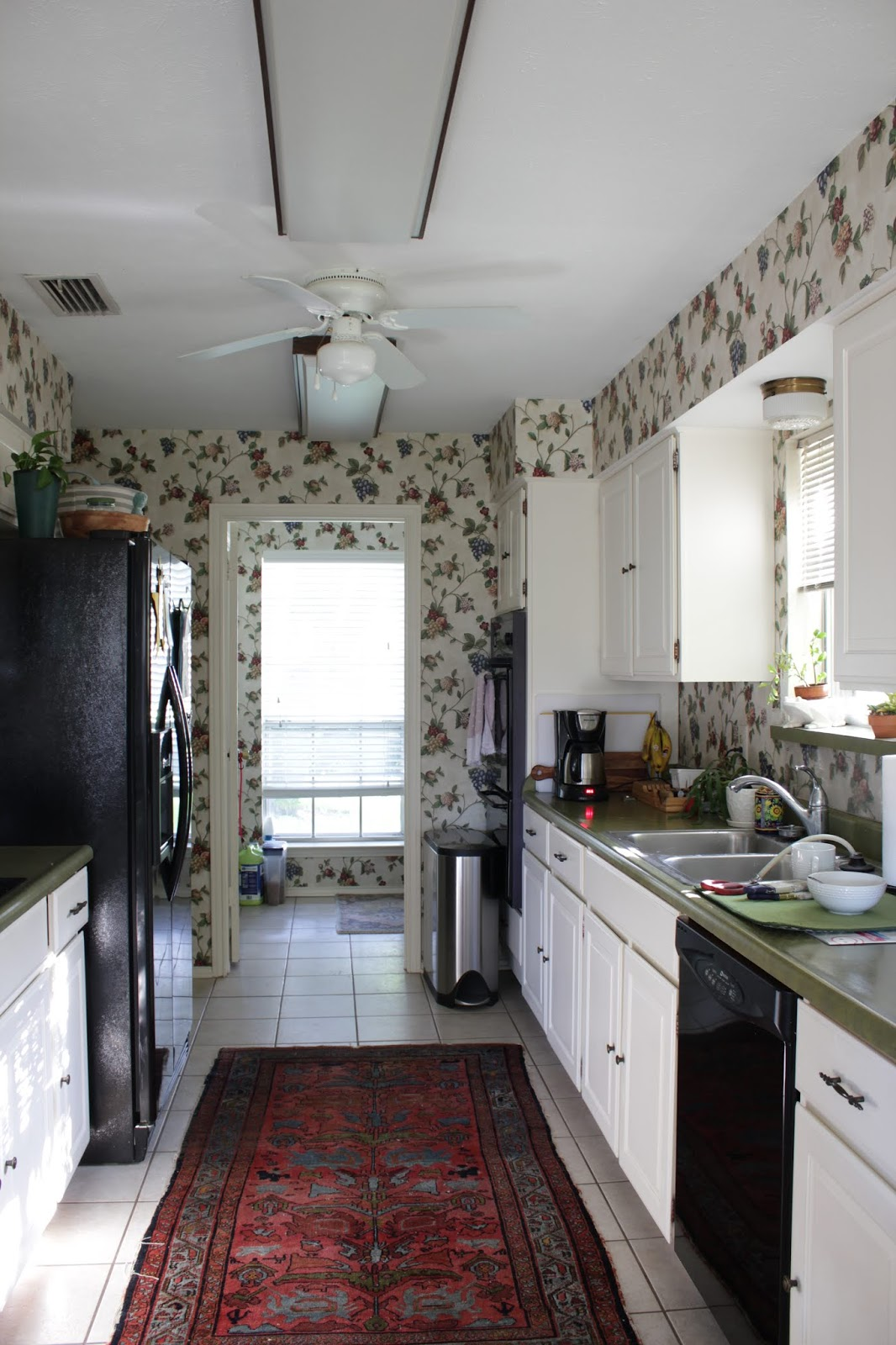 one room challange before: green countertops, outdated wallpaper, galley kitchen