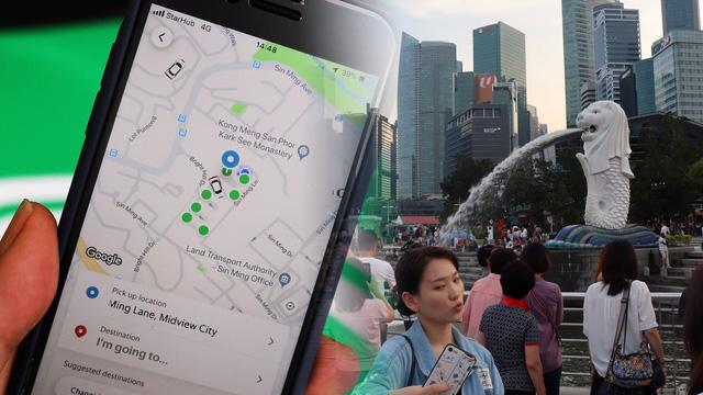 Grab và GoJek ở Singapore: Phát khẩu trang và dung dịch khử trùng cho tài xế