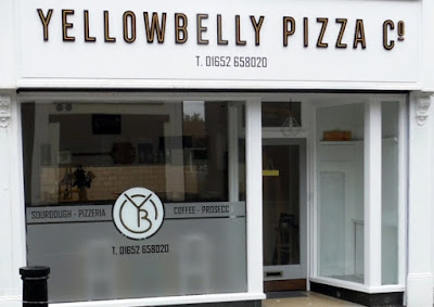 Picture of the  frontage of the Yellow Belly Pizza Company Pizzeria in Brigg town centre - opened June 2019