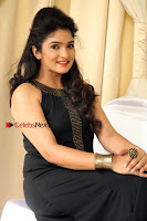 Kannada Actress Divya Uruduga Pos in Black Long Dress at Huliraaya Movie Audio Release Event  0009.jpg