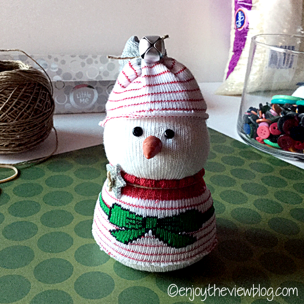 "snowbaby ""dressed"" using a holiday baby sock"