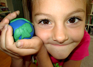 Using modeling clay, Tessa created a model of the Earth with secret layers inside.