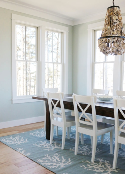 Coastal Dining Room with Light Blue Coral Area Rug and Oyster Chandelier