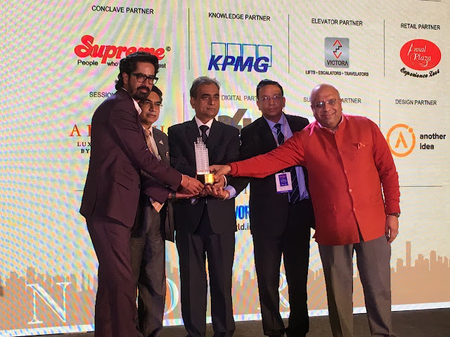 (LtoR) Mr. Ssumit Berry receiving the award from Pro PSN Rao,Chairman- Delhi Urban Art Commission,Rakesh Goyal,Vice Chairman, Rail Land D