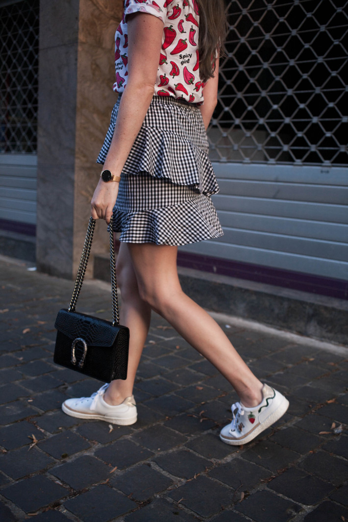 Outfit: gingham ruffle skirt, patchwork sneakers