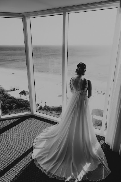 Professional wedding photos of bride with tropical view.