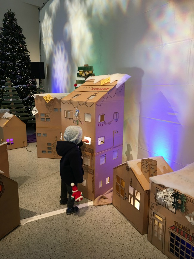 boy-at-millenium-centre-at-the-arctic-display-looking-at-cardboard-lighted-houses