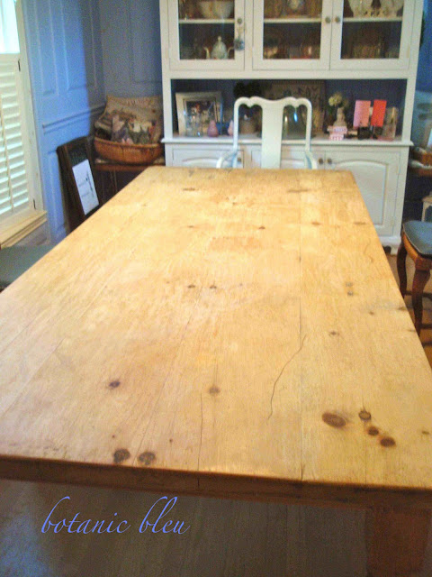 Reclaimed pine table wood after scrapping old wax down to the bare wood