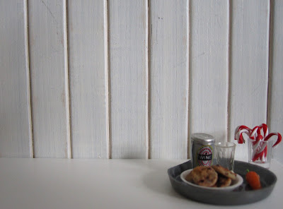 Modern one-twelfth scale tray for Santa, with a can of wine, a plate of cookies, a glass of candy canes and a carrot for the reindeer.