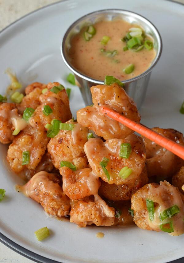 bang bang shrimp picked up with chopsticks