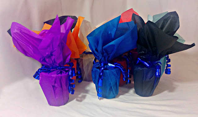 A  collection of finished party favours in assorted colours.
