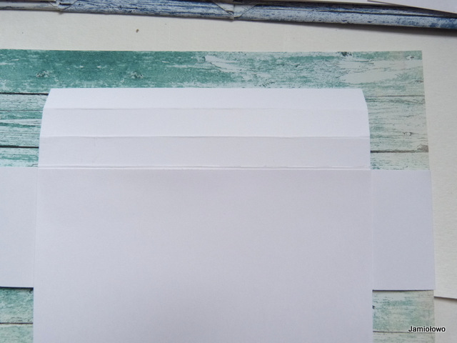 sposób przełożenia papieru przez wąski pasek