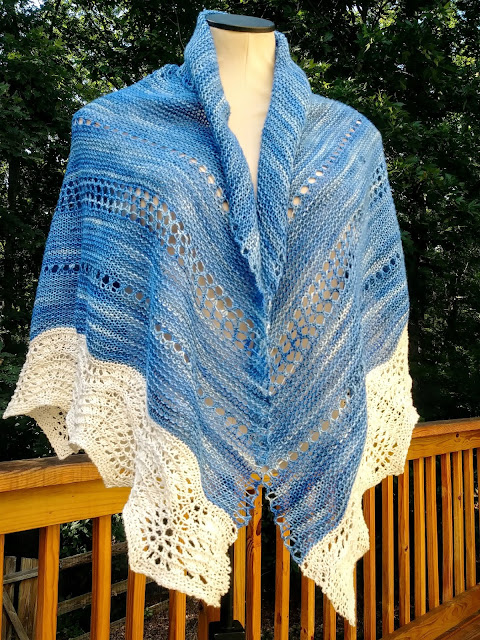 lace border knit on the outer edge of a simple garter stitch semi circle prayer shawl