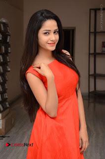 Telugu Actress Divya Nandini Stills in Orange Sleeveless Gown at Chennai Chaitrama Movie le Launch Event  0018.JPG