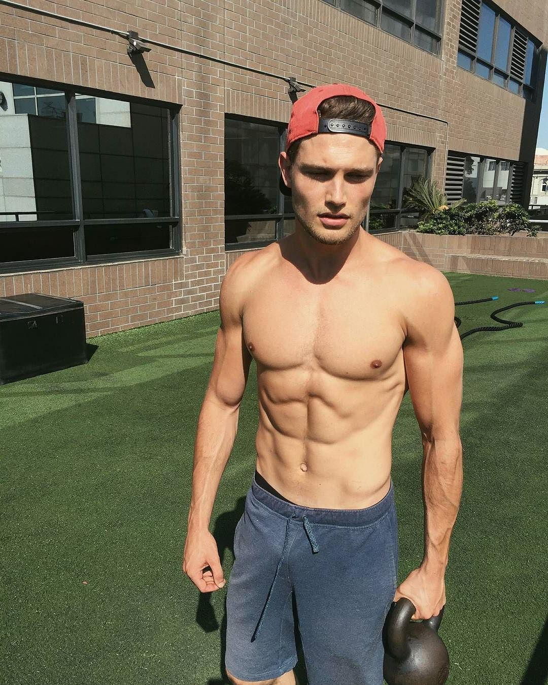 fit-guy-abs-shirtless-pecs-lifting-weights-jawline
