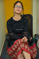 Aditi Myakal in Spicy Red Short Skirt and Transparent Black Top at at Big FM For Promotion of Movie Ami Tumi 012.JPG
