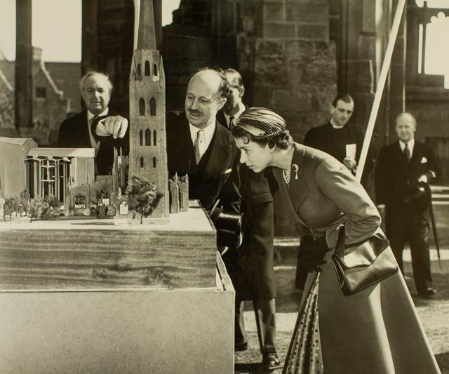 Basil Spence explaining the site of the new Cathedral to Her Majesty The Queen