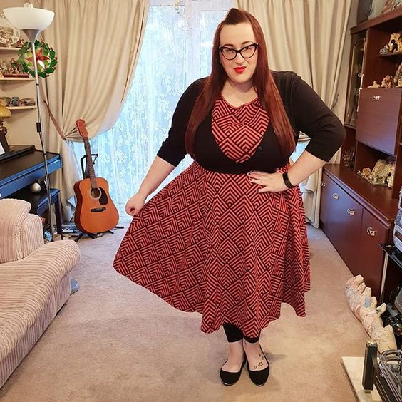 plus size girl wearing Lady V London Cerise Chevron Hepburn Dress