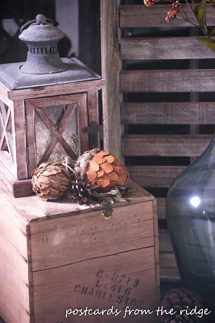 wood lantern and fall decor on old wooden crate