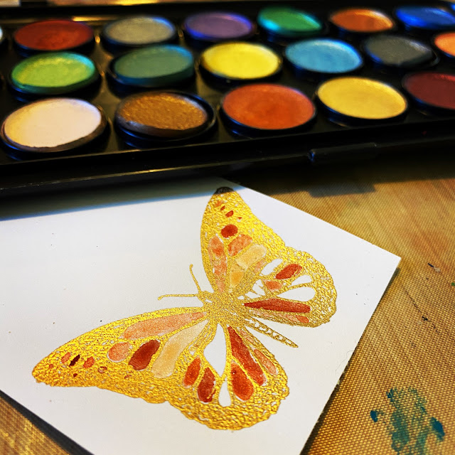 Metallic Watercolors applied to a STAMPlorations butterfly stamp that's been embossed in gold