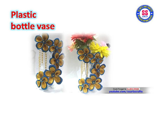 Here is plastic bottle crafts images,plastic bottle arts and crafts for kids,crafts from plastic bottle,plastic bottle wall decor ideas,plastic bottle wall hanging ideas,how to make toys from plastic bottle,how to make flower vase from plastic bottle,best out of waste from plastic bottle,recycled crafts ideas,how to make things from plastic bottle,how to make innovative flower vase from plastic bottle and foam flowers